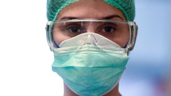 Medical worker in mask - Sputnik International