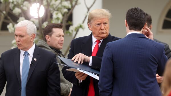"""U.S. President Donald Trump stands with Vice President Mike Pence as he prepares to participate in a televised Fox News Channel """"virtual town hall"""" on the coronavirus response in the Rose Garden of White House in Washington, U.S. March 24, 2020. - Sputnik International"""