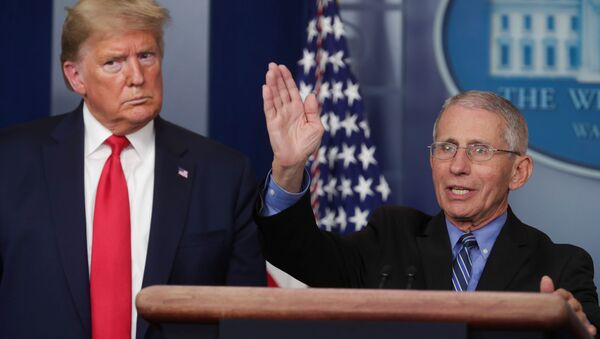U.S. President Donald Trump listens as Dr. Anthony Fauci, Director of the National Institute of Allergy and Infectious Diseases, addresses the coronavirus task force daily briefing at the White House in Washington, U.S., March 24, 2020. - Sputnik International