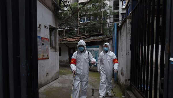 Community workers in protective suits disinfect a residential compound in Wuhan, the epicentre of the novel coronavirus outbreak, Hubei province, China March 6, 2020. - Sputnik International