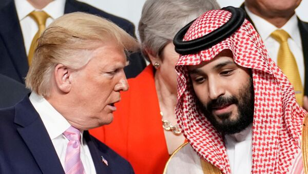 U.S. President Donald Trump speaks with Saudi Arabia's Crown Prince Mohammed bin Salman during family photo session with other leaders and attendees at the G20 leaders summit in Osaka, Japan, June 28, 2019.   - Sputnik International