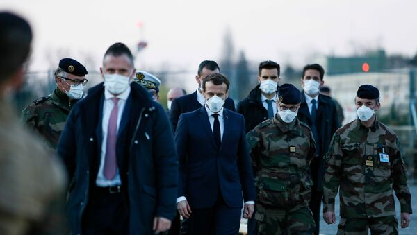 French President Emmanuel Macron wears a face mask during his visit to the military field hospital outside the Emile Muller Hospital in Mulhouse, eastern France March 25, 2020, during a strict lockdown in France to stop the spread of the coronavirus disease (COVID-19).   - Sputnik International