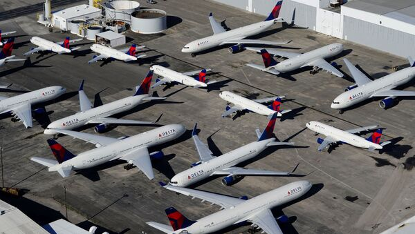 Delta Air Lines passenger planes are seen parked due to flight reductions made to slow the spread of coronavirus disease (COVID-19), at Birmingham-Shuttlesworth International Airport in Birmingham, Alabama, U.S. March 25, 2020. - Sputnik International