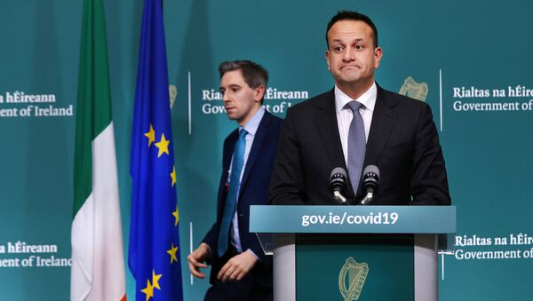 Ireland's Prime Minister Taoiseach Leo Varadkar and Health Minister Simon Harris attend a news conference on the ongoing situation with the coronavirus disease (COVID-19) at Government Buildings in Dublin, Ireland March 24, 2020. - Sputnik International