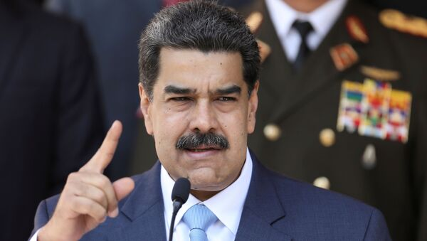Venezuela's President Nicolas Maduro speaks during a news conference at Miraflores Palace in Caracas, Venezuela, March 12, 2020. - Sputnik International