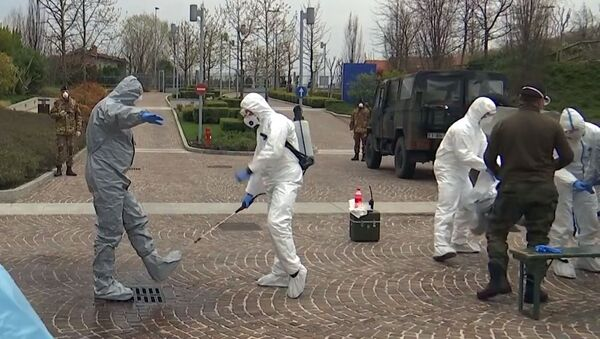 Russian military experts are disinfecting suits after visiting hospital facilities for elderly people to fight against the COVID-19 coronavirus infection, in Bergamo, Italy - Sputnik International