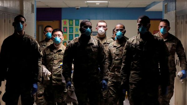 Members of Joint Task Force 2, composed of soldiers and airmen from the New York Army and Air National Guard, work to sanitize the New Rochelle High School during the coronavirus disease (COVID-19) outbreak in New Rochelle, New York, U.S., March 21, 2020 - Sputnik International