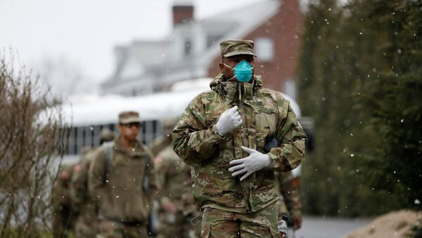 Members of Joint Task Force 2, composed of soldiers and airmen from the New York Army and Air National Guard, arrive to sanitize and disinfect the Young Israel of New Rochelle synagogue, as snow falls during the coronavirus disease (COVID-19) outbreak in New Rochelle, New York, U.S., March 23, 2020 - Sputnik International
