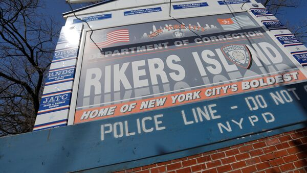 Signage is seen outside of Rikers Island, a prison facility, where multiple cases of the coronavirus disease (COVID-19) have been confirmed in Queens, New York City, U.S., March 22, 2020 - Sputnik International