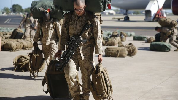 U.S. Marines and Sailors with Marine Rotational Force – Darwin 2018 collect their luggage and proceed to customs after arriving at the Royal Australian Air Force Base Darwin, Australia, April 17 - Sputnik International