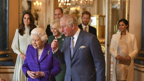 Queen Elizabeth II is joined by Prince Charles, the Prince of Wales, and at rear, from left, Kate, Duchess of Cambridge, Camilla, Duchess of Cornwall, Prince William, Prince Harry and Meghan, Duchess of Sussex during a reception at Buckingham Palace, London, Tuesday 5 March 2019, to mark the 50th anniversary of the investiture of the Prince of Wales. - Sputnik International