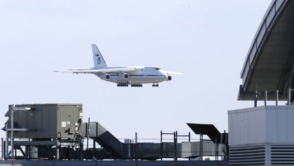A Russian military transport plane carrying medical equipment, masks and supplies lands at JFK International Airport during the outbreak of the coronavirus disease (COVID-19) in New York City, New York, U.S., April 1, 2020 - Sputnik International