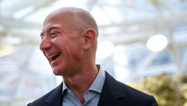 Amazon founder and CEO Jeff Bezos laughs as he talks to the media while touring the new Amazon Spheres during the grand opening at Amazon's Seattle headquarters in Seattle, Washington, U.S., January 29, 2018 - Sputnik International