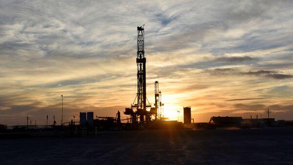 Drilling rigs operate at sunset in Midland, Texas, U.S., February 13, 2019 - Sputnik International