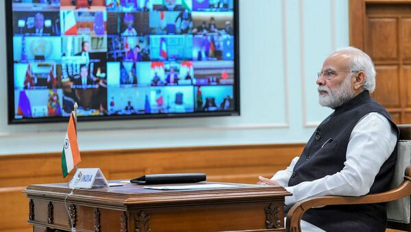 In this handout photo taken and released by Indian Press Information Bureau (PIB) on March 26, 2020, India's Prime Minister Narendra Modi attends a videoconference with G20 leaders to discuss the COVID-19 coronavirus, in New Delhi - Sputnik International