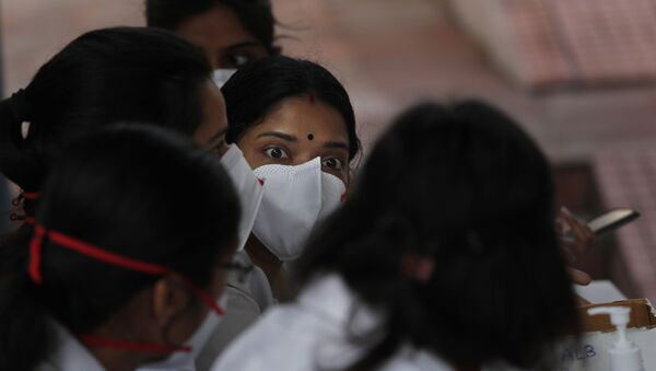 Indian doctors wearing masks at a clinic where they provide free homeopathy medicine for prevention of COVID-19 at a government run homeopathic hospital in New Delhi, India, Thursday, March 12, 2020 - Sputnik International