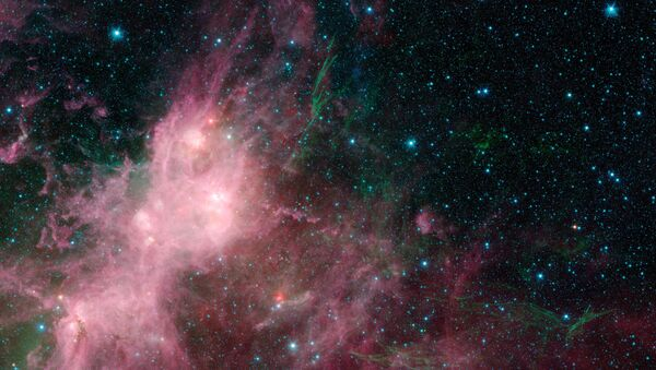 This image made available by NASA shows infrared data from the Spitzer Space Telescope and Wide-field Infrared Survey Explorer (WISE) in an area known as the W3 and W5 star-forming regions within the Milky Way Galaxy - Sputnik International