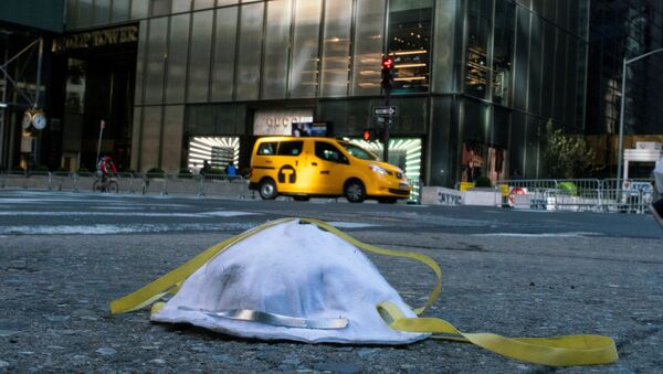 A face mask used to protect from the coronavirus disease (COVID-19) is seen on the ground near Trump Tower in New York City, New York, U.S., March 14, 2020 - Sputnik International
