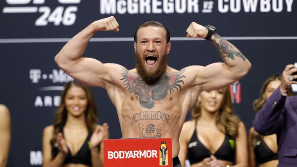 Welterweight fighter Conor McGregor poses on the scale during a ceremonial weigh-in for UFC 246 at Park Theater at Park MGM on January 17, 2020 in Las Vegas, Nevada - Sputnik International