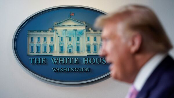U.S. President Donald Trump speaks in front of the White House seal in the press briefing room during the daily coronavirus task force briefing at the White House in Washington, U.S., April 4, 2020 - Sputnik International