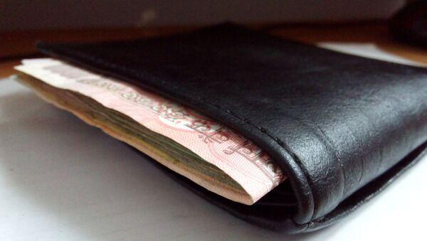 Black leather wallet with money - Sputnik International