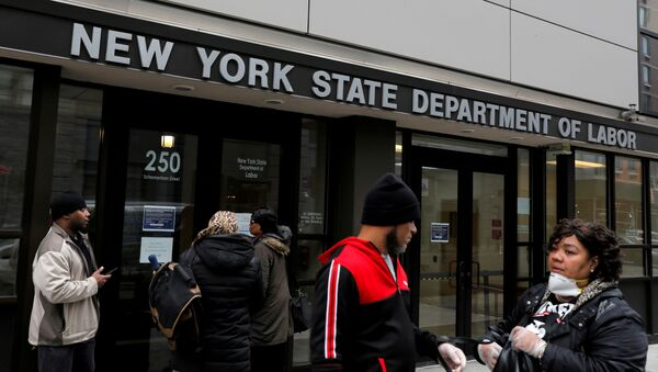 People gather at the entrance for the New York State Department of Labor offices, which closed to the public due to the coronavirus disease (COVID-19) outbreak in the Brooklyn borough of New York City, U.S., March 20, 2020 - Sputnik International