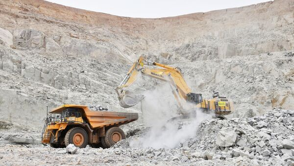 An excavator driven by Rosalie Guirou Kulga, 30, clears out rocks into a dumper at the gold mine, operated by Endeavour Mining Corporation in Hounde, Burkina Faso. Picture taken February 11, 2020.  - Sputnik International