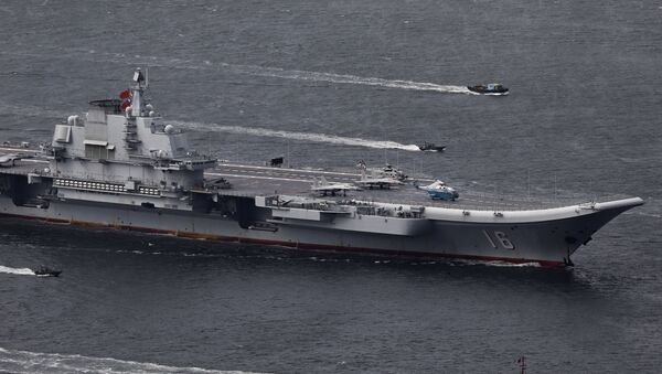 In this July 7, 2017, file photo, the Liaoning, China's first aircraft carrier, sails into Hong Kong for a port call to celebrate the 20th anniversary of the People's Liberation Army (PLA) garrison's presence in the semi-autonomous Chinese city and former British colony - Sputnik International
