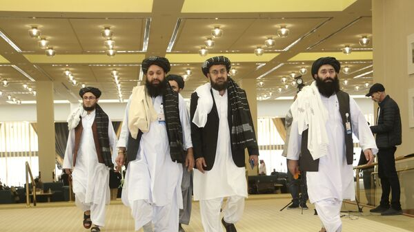 Afghanistan's Taliban delegation arrive for the agreement signing between Taliban and U.S. officials in Doha, Qatar, Saturday, Feb. 29, 2020. - Sputnik International