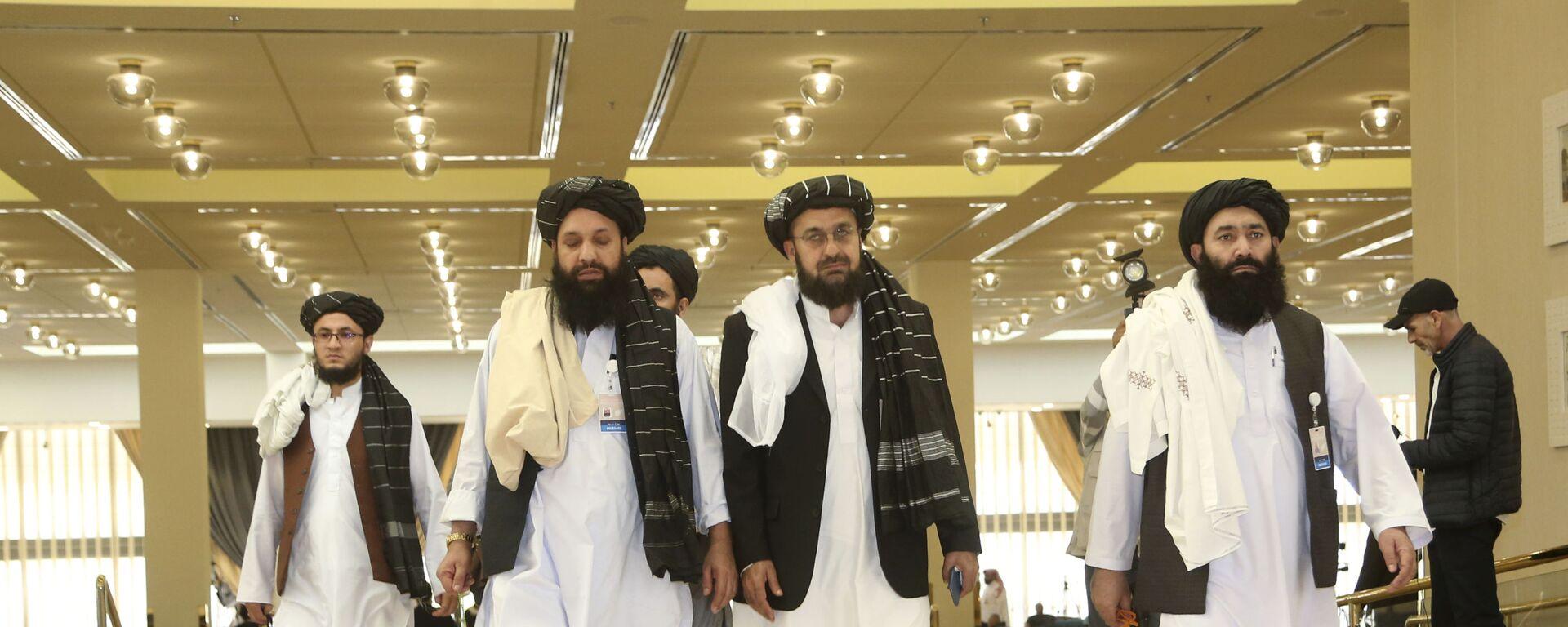 Afghanistan's Taliban delegation arrive for the agreement signing between Taliban and U.S. officials in Doha, Qatar, Saturday, Feb. 29, 2020. - Sputnik International, 1920, 14.08.2021