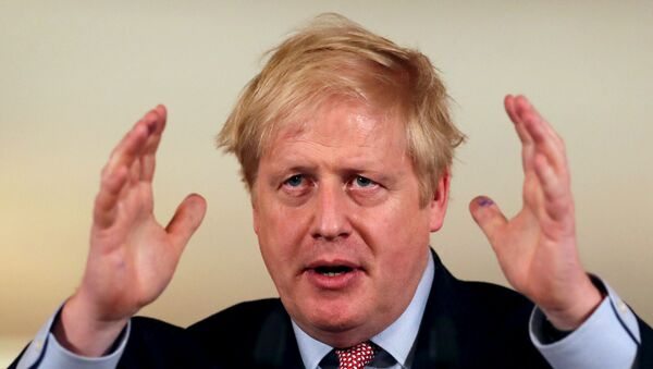 British Prime Minister Boris Johnson holds a news conference addressing the government's response to the coronavirus outbreak, at Downing Street in London, Britain March 12, 2020.  - Sputnik International