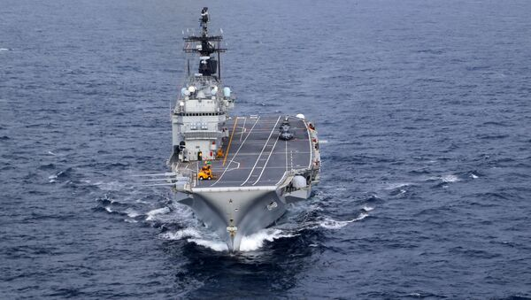 In this Friday, Nov. 25, 2016 photo, the Italian Navy Giuseppe Garibaldi light aircraft carrier, seen from a helicopter, sails on the Mediterranean Sea, off the coast of Sicily, part of the European Union's naval force Operation Sophia. Operation Sophia was launched to disrupt human smuggling operations in the Central Mediterranean. - Sputnik International
