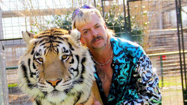 This undated photo courtesy of Netflix shows Joseph Joe Exotic Maldonado-Passage with one of his tigers - Sputnik International