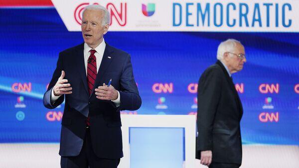 In this March 15, 2020, file photo, former Vice President Joe Biden prepares for a Democratic presidential primary debate with Sen. Bernie Sanders, I-Vt., at CNN Studios in Washington. - Sputnik International