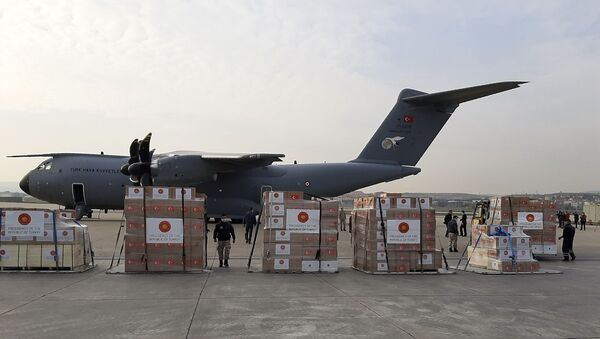 Soldiers prepare to load a military cargo plane with Personal Protection Equipment heading to Italy and Spain to help the countries combat the new coronavirus outbreak, in Ankara, Turkey, Wednesday, 1 April 2020. The new coronavirus causes mild or moderate symptoms for most people, but for some, especially older adults and people with existing health problems, it can cause more severe illness or death. - Sputnik International