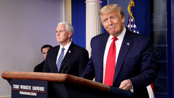 U.S. President Donald Trump arrives with Vice President Mike Pence to lead the daily coronavirus task force briefing at the White House in Washington, U.S., April 9, 2020 - Sputnik International