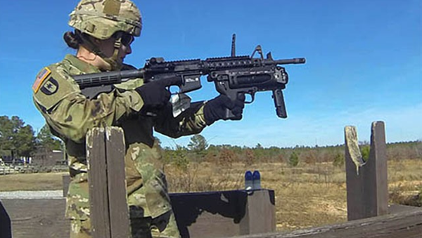 Sgt. Keala Burks, a drill sergeant with Alpha Company, 3rd Battalion, 60th Infantry Regiment, fires one of the nearly 30 rounds she shot during training on the M320 grenade launcher. - Sputnik International