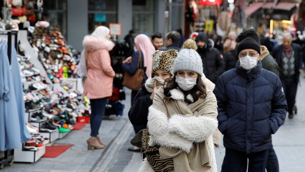 People wear protective face masks due to coronavirus concerns in Istanbul, Turkey March 16, 2020. - Sputnik International