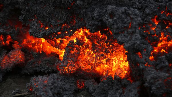 A close up of lava from an eruption on Holuhraun, northwest of the Dyngjujoekull glacier in Iceland, Monday, Sept. 1, 2014.  Lava fountains danced along a lengthy volcanic fissure near Iceland's subglacial Bardarbunga volcano Sunday, prompting authorities to raise the aviation warning code to the highest level and close the surrounding airspace. The warning was lowered 12 hours later as visibility improved and it was clear that no volcanic ash was detected. - Sputnik International