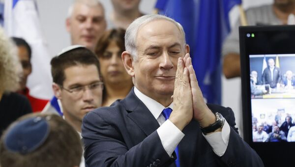Israel's Prime Minister and leader of the Likud Party Benjamin Netanyahu gestures as he delivers a statement in the Israeli central city of Petah Tikva on March 7, 2020.  - Sputnik International