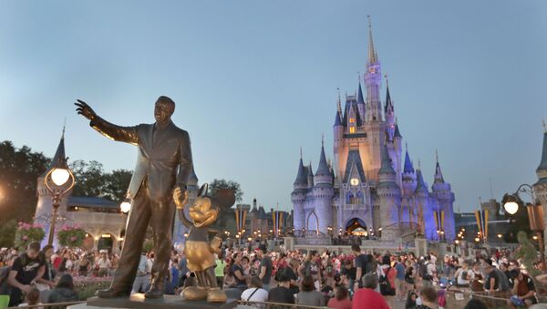 In this Wednesday, Jan. 15, 2020 photo, a statue of Walt Disney and Mickey Mouse is seen in front of the Cinderella Castle at the Magic Kingdom theme park at Walt Disney World in Lake Buena Vista, Fla. Florida tourism officials say cases of the new coronavirus are having little visible impact on the theme park industry so far.  - Sputnik International
