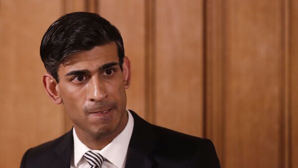In this file photo dated Tuesday, March 17, 2020, Britain's Chancellor Rishi Sunak gives a press conference about the ongoing situation with the COVID-19 coronavirus outbreak inside 10 Downing Street in London. - Sputnik International