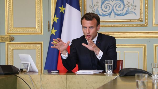 French President Emmanuel Macron takes part in a video conference with World Health Organization (WHO) general director Tedros Adhanom Ghebreyesus at the Elysee Palace in Paris, France April 8, 2020 - Sputnik International