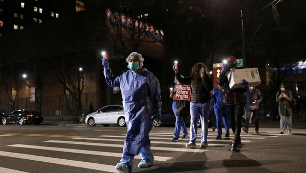 Nurses gather for a candlelight vigil to honor healthcare workers, during the outbreak of the coronavirus disease (COVID-19) at Lincoln Hospital in the Bronx borough of New York City, U.S., April 14, 2020 - Sputnik International