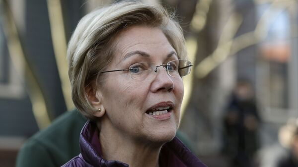 FILE - In this Thursday, March 5, 2020, file photo, Sen. Elizabeth Warren, D-Mass., speaks to the media outside her home in Cambridge, Mass., after she dropped out of the Democratic presidential race - Sputnik International