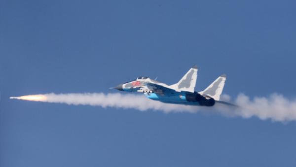 A MiG-29 of the Korean People's Anti-Air Force (KPAAF) fires a missile at a simulated target during air combat exercises - Sputnik International