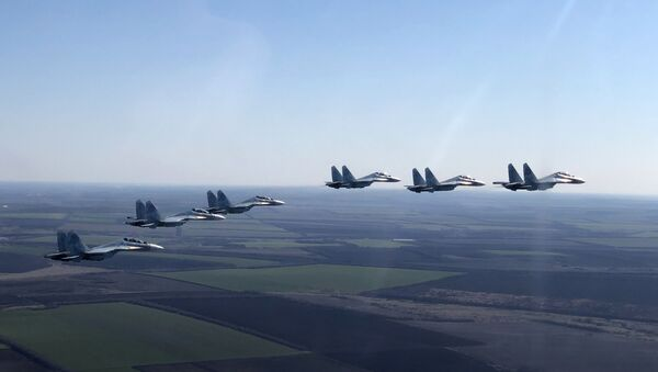 In this handout photo released by the Russian Defence Ministry, Su-30SM jet fighters of the 4th Air and Air Defence Forces Army of the Russian Southern Military District fly in formation during a rehearsal for the Victory Day parade in Rostov-on-Don, which marks the 75th anniversary of the victory over Nazi Germany in World War Two, in Rostov region, Russia - Sputnik International