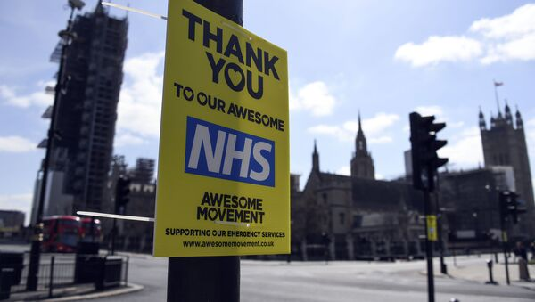 A message in support to the NHS is seen in Westminster, during to the Coronavirus outbreak, in London, Tuesday, April 14, 2020 - Sputnik International