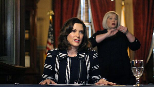In this photo provided by the Michigan Office of the Governor, Michigan Gov. Gretchen Whitmer addresses the state during a speech in Lansing, Mich., Thursday, April 2, 2020 - Sputnik International