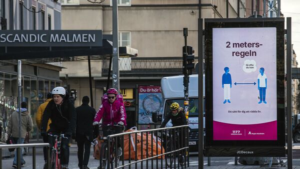 An advertisement of the healthcare services of Sweden instructs people to follow the 2 meters rule to reduce the risk of getting sick, in Stockholm on April 14, 2020. - Sputnik International